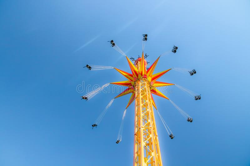 Kouvola, Finland - 18 May 2019: Ride Star Flyer in motion on sky background in amusement park Tykkimaki.  royalty free stock photography