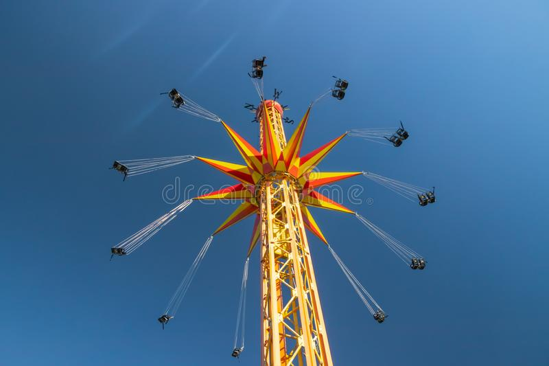 Kouvola, Finland - 18 May 2019: Ride Star Flyer in motion on sky background in amusement park Tykkimaki.  stock photos