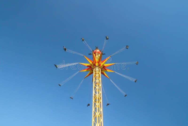 Kouvola, Finland - 18 May 2019: Ride Star Flyer in motion on sky background in amusement park Tykkimaki.  stock image