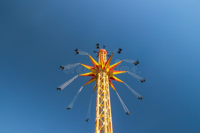 Kouvola, Finland - 18 May 2019: Ride Star Flyer in motion on sky background in amusement park Tykkimaki.  stock images