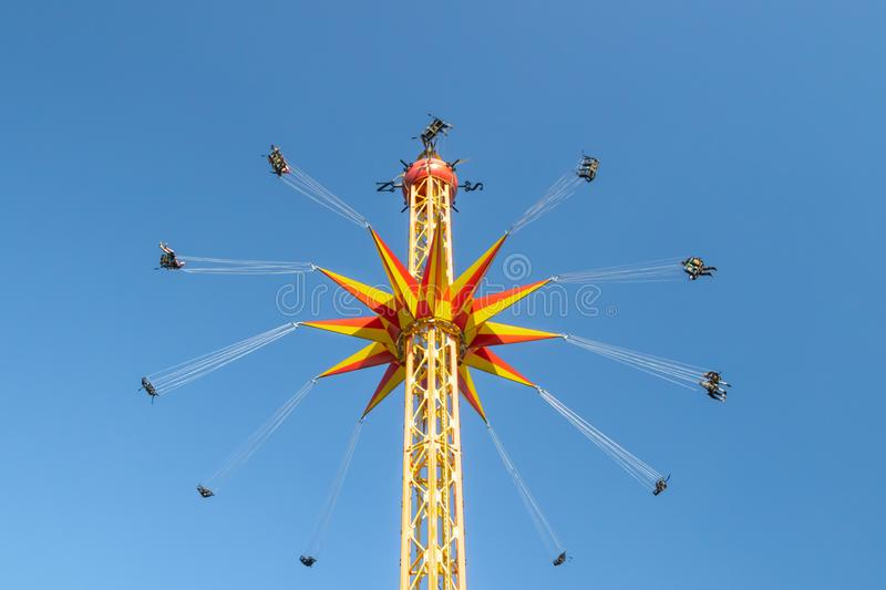 Kouvola, Finland - 18 May 2019: Ride Star Flyer in motion on sky background in amusement park Tykkimaki.  royalty free stock photos