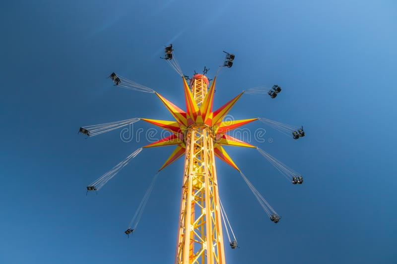 Kouvola, Finland - 18 May 2019: Ride Star Flyer in motion on sky background in amusement park Tykkimaki.  royalty free stock image