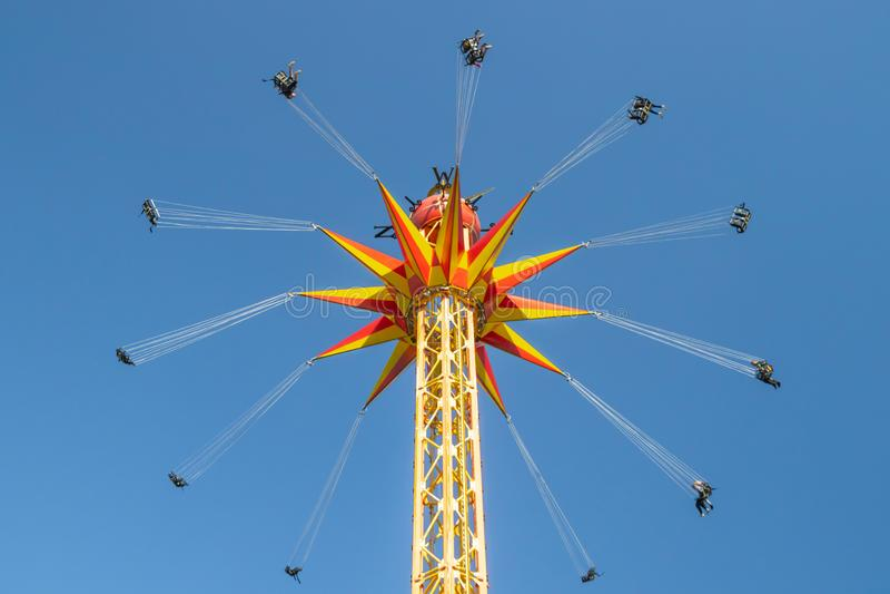Kouvola, Finland - 18 May 2019: Ride Star Flyer in motion on sky background in amusement park Tykkimaki.  stock photo
