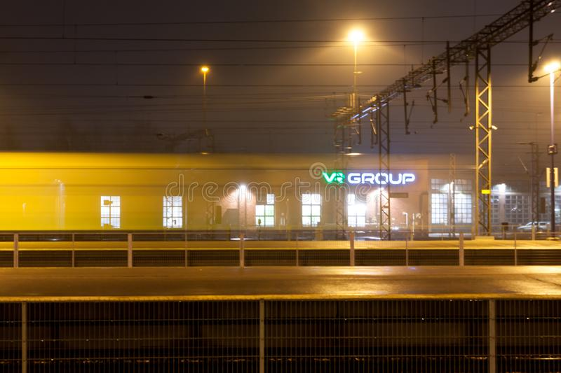 KOUVOLA, FINLAND - NOVEMBER 7, 2018: Train in motion on the station at night, long exposure photo.  stock images