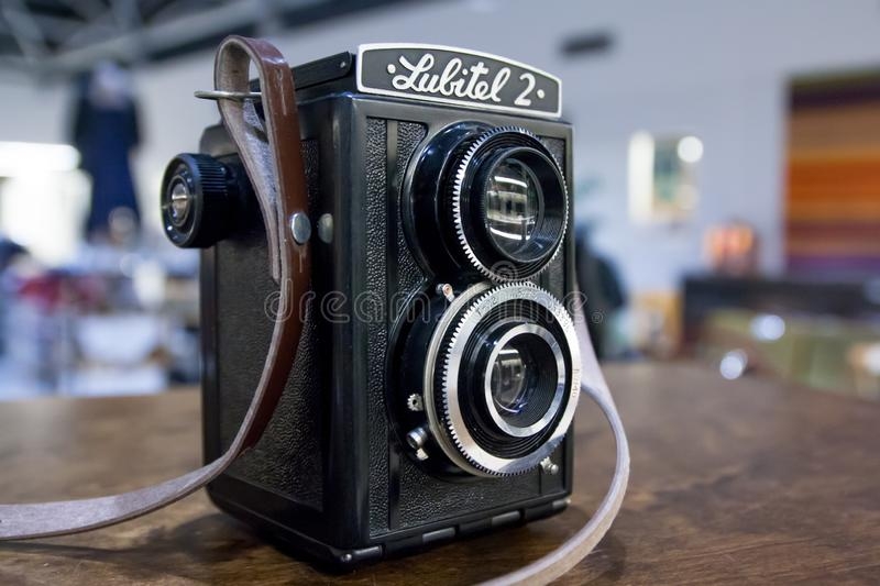 KOUVOLA, FINLAND - NOVEMBER 1, 2018: Vintage twin lens camera Lubitel on the table.  stock photos