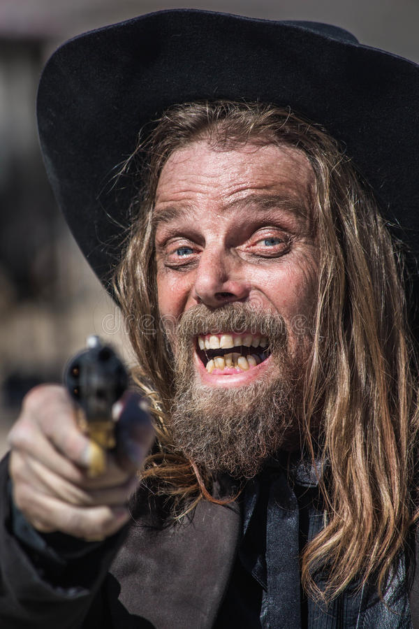 Kowbojów punktów pistolet przy Tobą obrazy royalty free