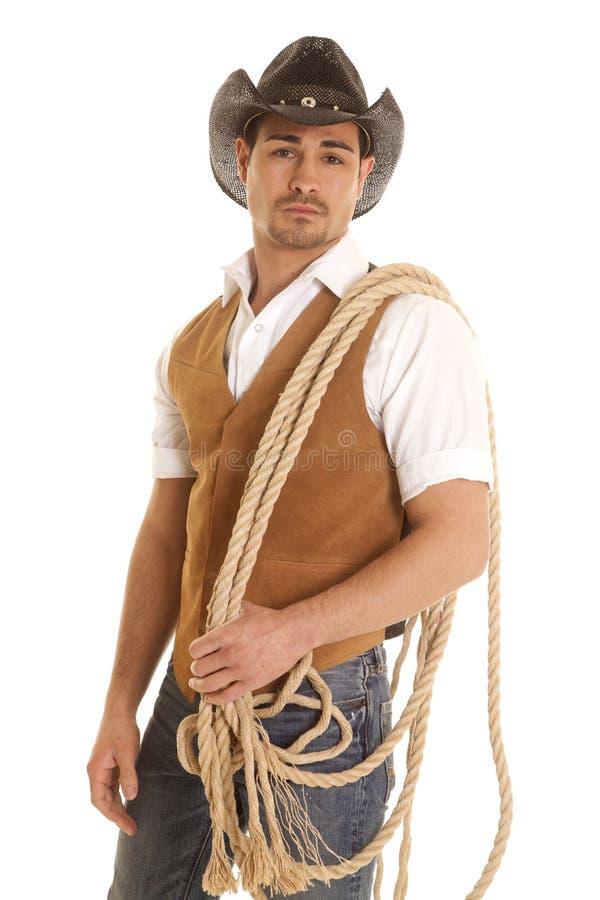 Kowboj w kamizelce z arkaną na ramieniu obraz royalty free