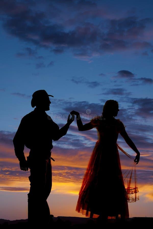 Kowbojska pary sylwetki chwyta ręka up obraca daleko od zdjęcia royalty free