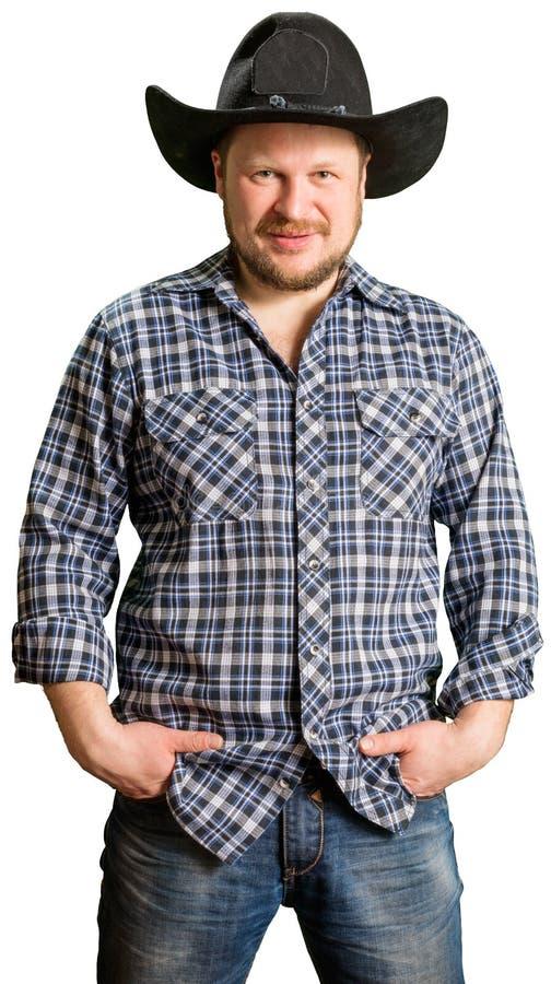 Kowbojski mężczyzna przy szkockiej kraty koszula z czarnym kapeluszem fotografia stock