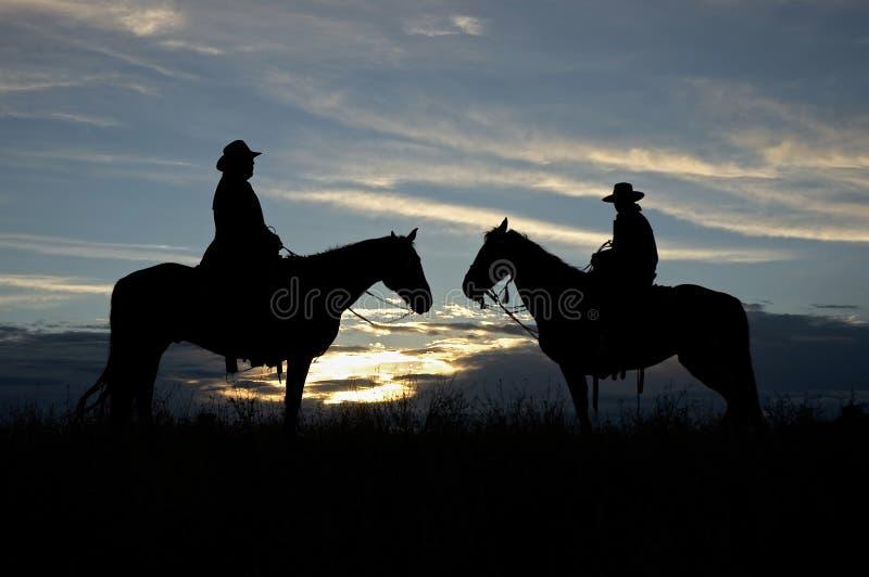 kowbojskie sylwetki fotografia royalty free