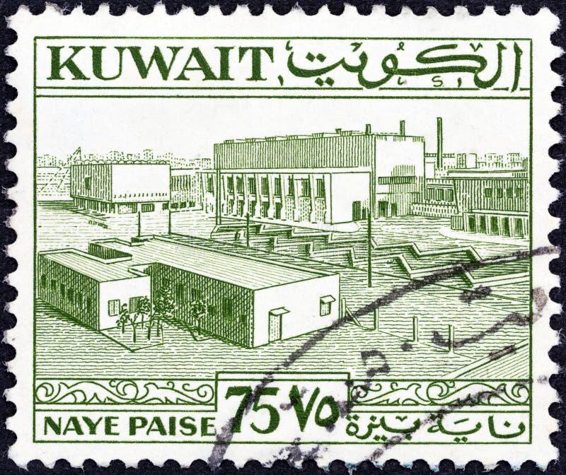 KOWEÏT - CIRCA 1958 : Un timbre imprimé au Koweït montre la place principale, au Koweït, vers 1958 images libres de droits