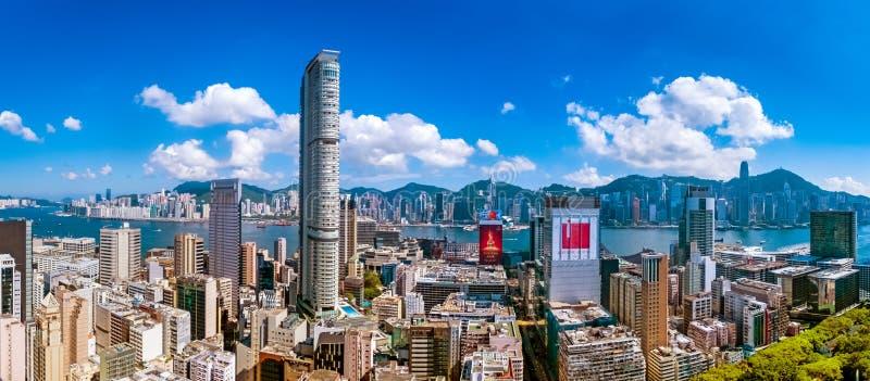 City view of Kowloon peninsula and Hong Kong island at hot afternoon stock images