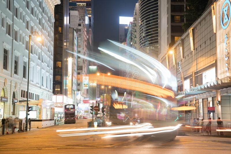 Night long exposure of passing vehicles on busy city street. KOWLOON HONG KONG, SEPTEMBER 20, 2017;Night long exposure swoosh of passing vehicles lights on busy royalty free stock photos