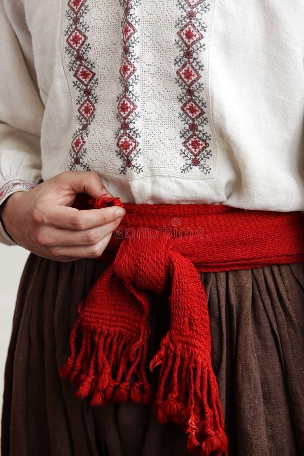 Kozak w haftowanej koszuli z czerwonym pasem zdjęcia royalty free