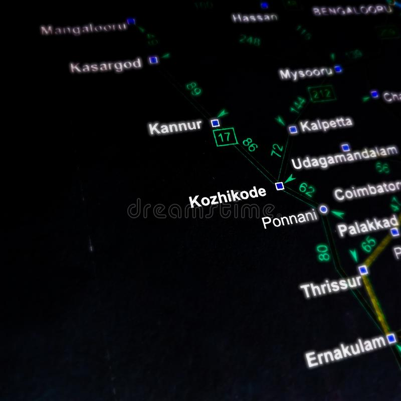 Kozhikode district name in India south religion displaying on black geographical location map. Territory, area, distance, tourism, asia, city, country, path stock photo