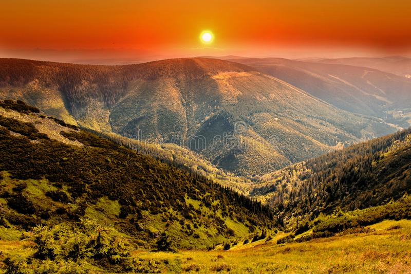 Kozi hrbety- Krkonose National park in Czech republic. The sunset view from mountain Krakonos and Kozi hrbety to the valley. There is Spindelurv mlyn. It is stock image