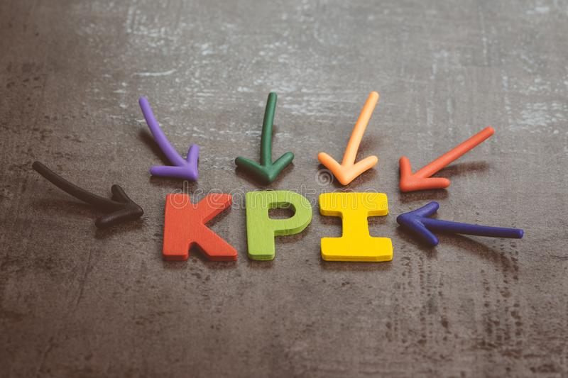 KPI, Key Performance Indicator business target and goal management concept by multiple arrow pointing to colorful alphabet acronym stock photos