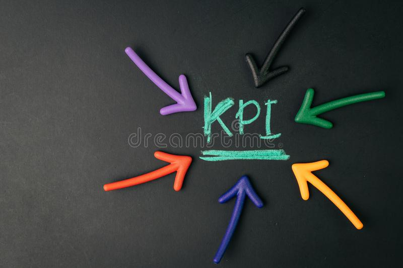 KPI, Key Performance Indicator, metrics to measure business success or marketing campaign goal and target achievement, arrow. Pointing to handwriting chalk word stock photo