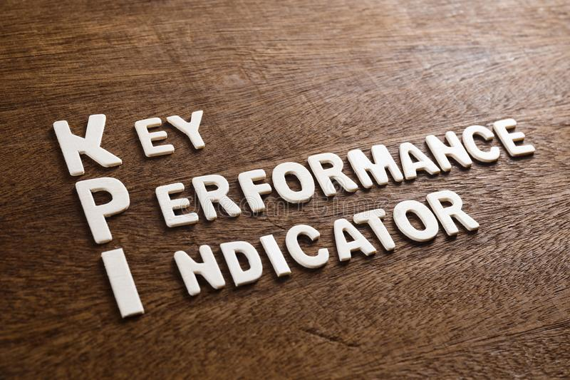 KPI Wood Letters. KPI Key Performance Indicator text by wood letters on wood texture stock photos