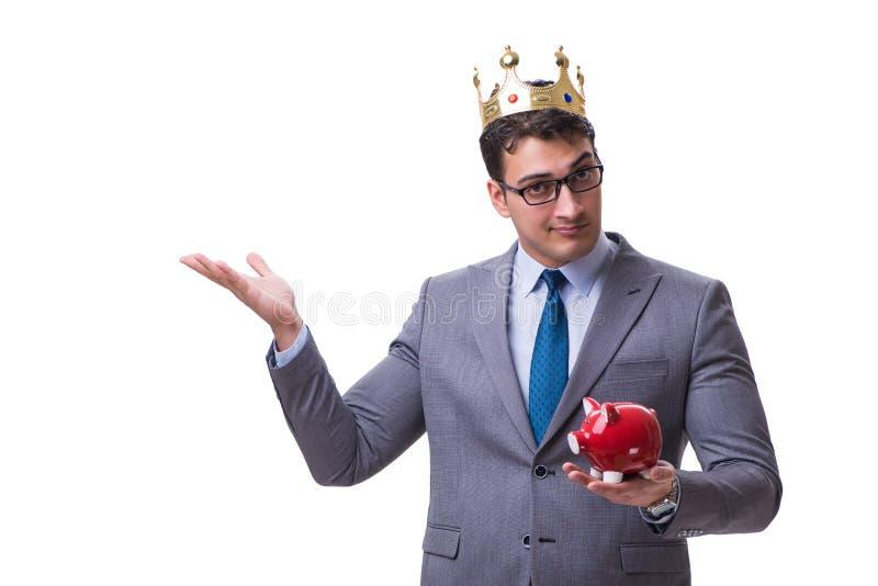 Królewiątko biznesmen trzyma prosiątko banka odizolowywający na białym backgrou zdjęcie royalty free