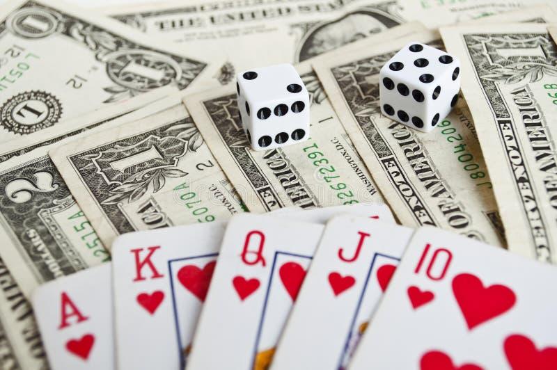 Królewski błysk z pieniądze i dices zdjęcie stock