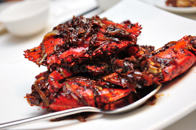 Krab in zwarte pepersaus stock fotografie