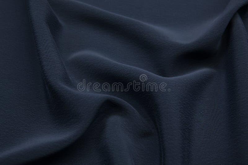 Krabb bakgrund för tygcloseuptextur arkivfoto