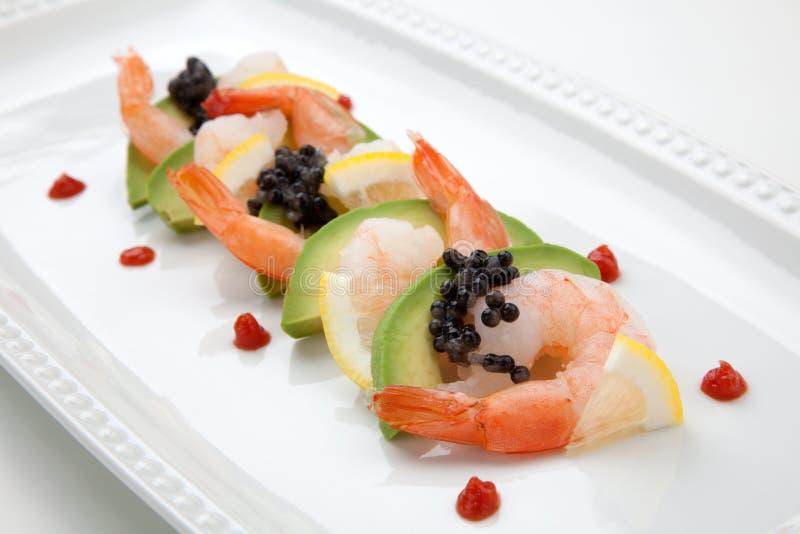 Krabbencocktail mit schwarzem Kaviar lizenzfreies stockfoto