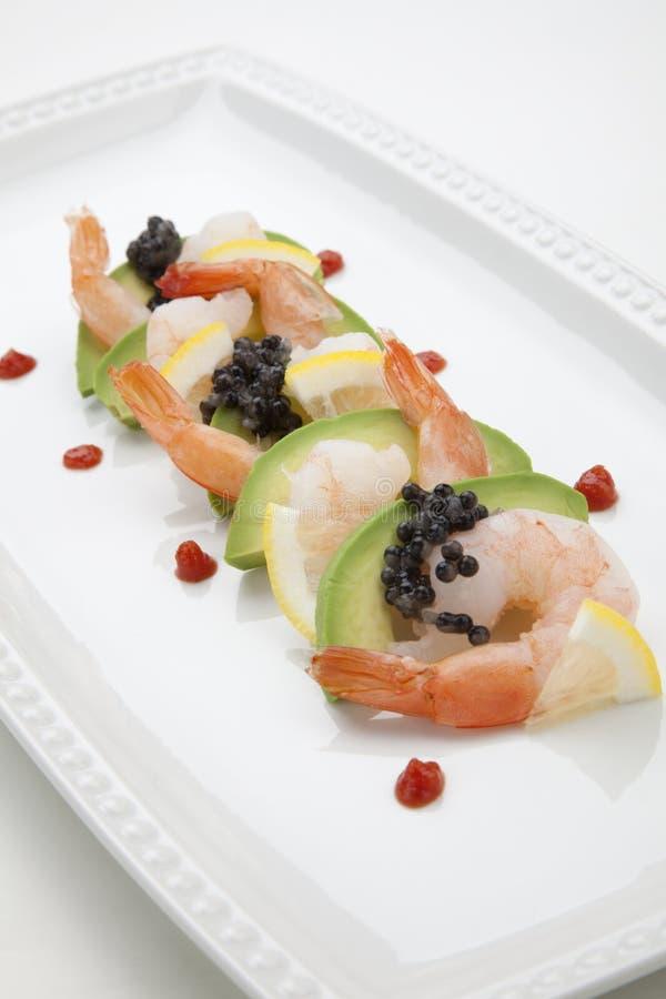Krabbencocktail mit schwarzem Kaviar lizenzfreie stockfotografie