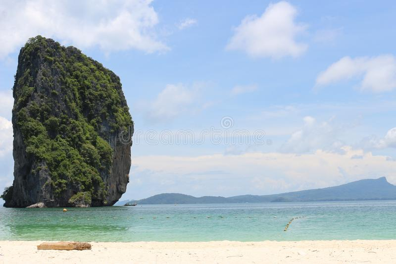 Krabi, beach, thailand, sea, sky, green, blue, travel, tour. Krabi, on southern Thailand's west coast, is a province characterized by craggy, sheer stock photography