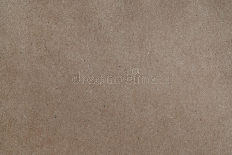 Kraft brown paper full frame macro background. Kraft brown paper full frame macro shot background stock image