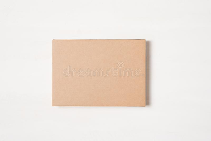 Kraft brown rectangular gift box on a light background.  stock image