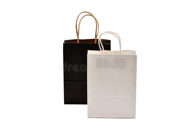 Kraft-cadeautassen voor kraft voor zwart-wit papier, geïsoleerd op witte achtergrond stock afbeeldingen