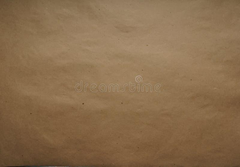 Kraft inpackningspapper ark Brun färg texturen Bästa sikt, närbild royaltyfri illustrationer