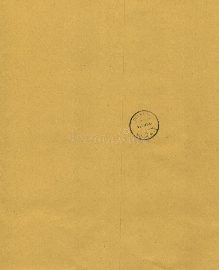Kraft paper background with postmark. Kraft paper background with black postmark royalty free stock image