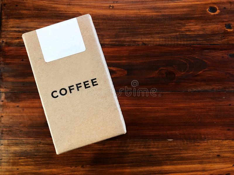 Kraft paper coffee box on the vintage Wooden table, stock images