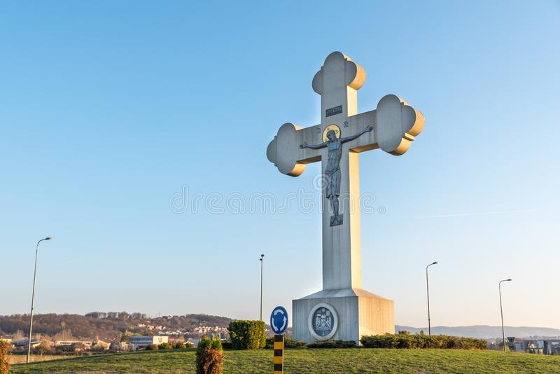 Big Orthodox Christian cross on the entrance to Kragujevac city as landmark and symbol for tourists. stock photo