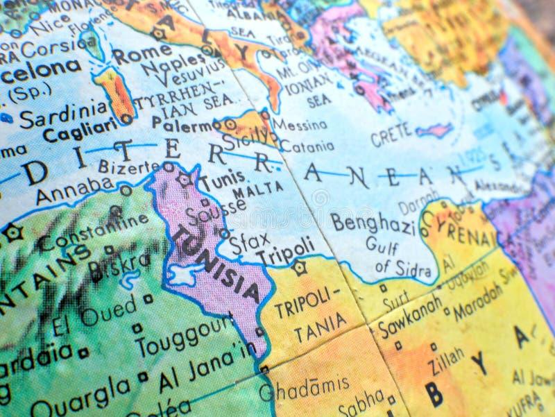 Kraj Tunezja i morza śródziemnomorskiego ostrość makro- strzał na kuli ziemskiej mapie dla podróży blogów, ogólnospołeczni środki zdjęcia royalty free