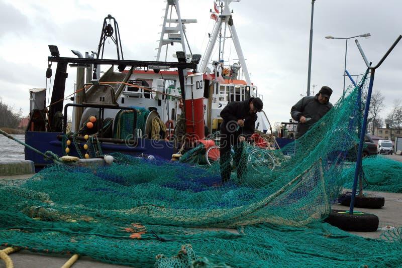 Krajacze i rybacy po łowić podczas zmroku bardzo, burzowy dzień obrazy stock