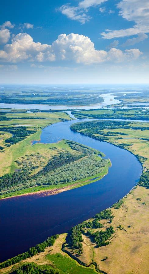 Krajobraz z rzeką i chmurami obraz royalty free