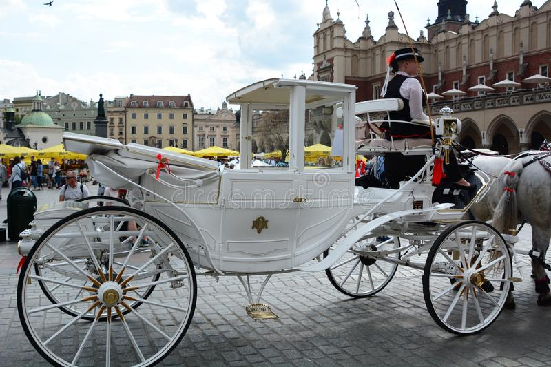 Touristic horse-drawn carriage. Main market square. Krakow. Poland. Kraków is the second largest and one of the oldest cities in Poland, situated on the royalty free stock photo
