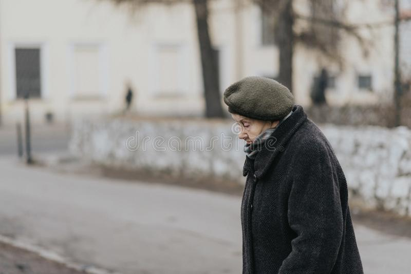 KRAKOV, POLAND - DECEMBER 23, 2017: old women walking during the winter in Krakov royalty free stock image