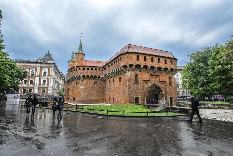 Krakow Barbican and rainy cityscape. Krakow, Poland - May 20, 2019: The Krakow Barbican and rainy cityscape. It is a historic gateway leading into the Old Town stock images