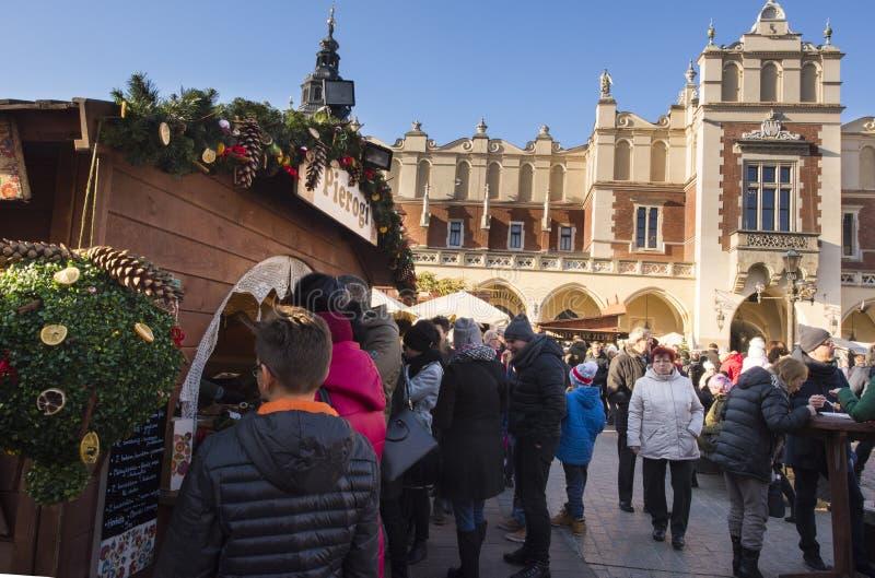 Krakow Christmas Market 2017. KRAKOW, POLAND - DECEMBER 10, 2017: Annual Christmas market in Krakow`s medieval Old Town Main Market Square. Pierogi stall in stock photo