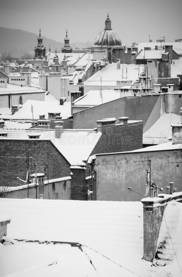 Krakow in Christmas time, aerial view on snowy roofs in central part of city. BW photo. Poland. Europe. Krakow in Christmas time, aerial view on snowy roofs in stock photography