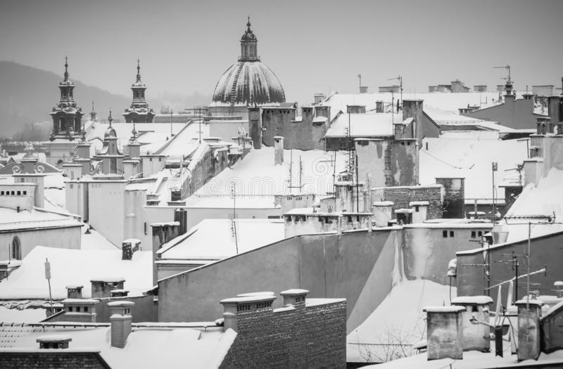 Krakow in Christmas time, aerial view on snowy roofs in central part of city. BW photo. Poland. Europe.  royalty free stock photography