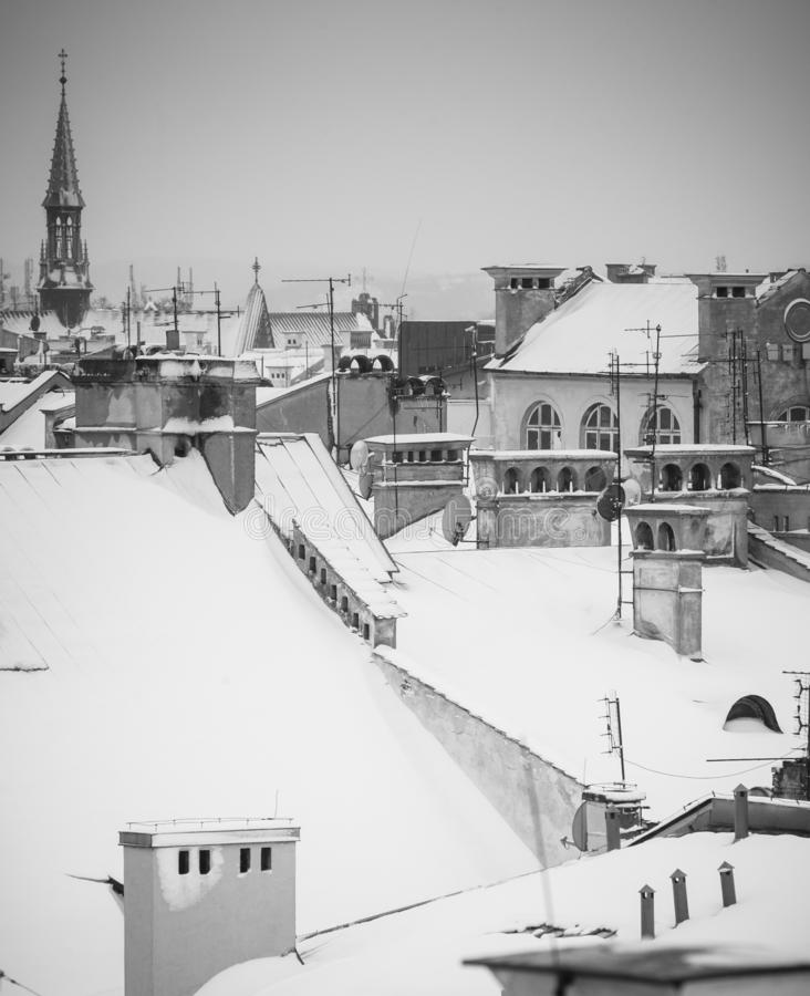 Krakow in Christmas time, aerial view on snowy roofs in central part of city. BW photo. Poland. Europe.  royalty free stock photos