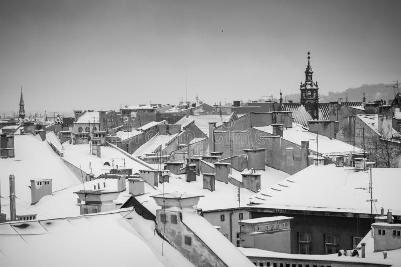 Krakow in Christmas time, aerial view on snowy roofs in central part of city. BW photo. Poland. Europe. Krakow in Christmas time, aerial view on snowy roofs in stock photo
