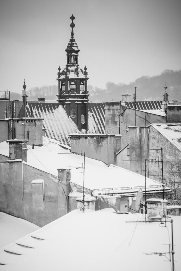 Krakow in Christmas time, aerial view on snowy roofs in central part of city. BW photo. Poland. Europe.  stock image