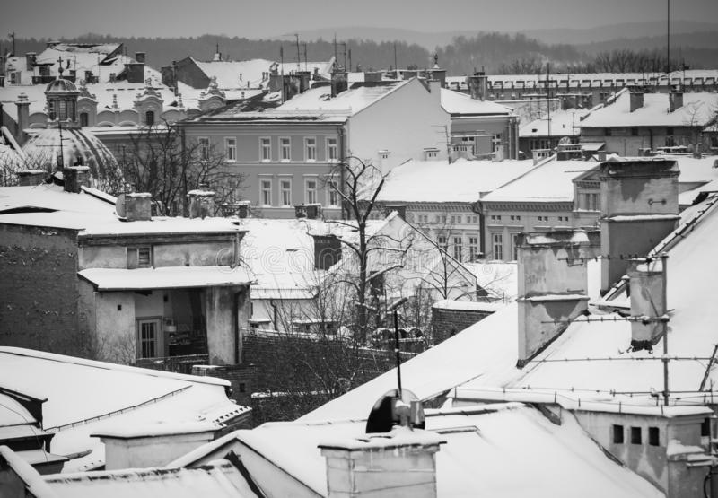 Krakow in Christmas time, aerial view on snowy roofs in central part of city. BW photo. Poland. Europe.  stock images